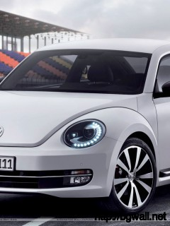 2012 Volkswagen Beetle On Race Course Wallpaper Full Size