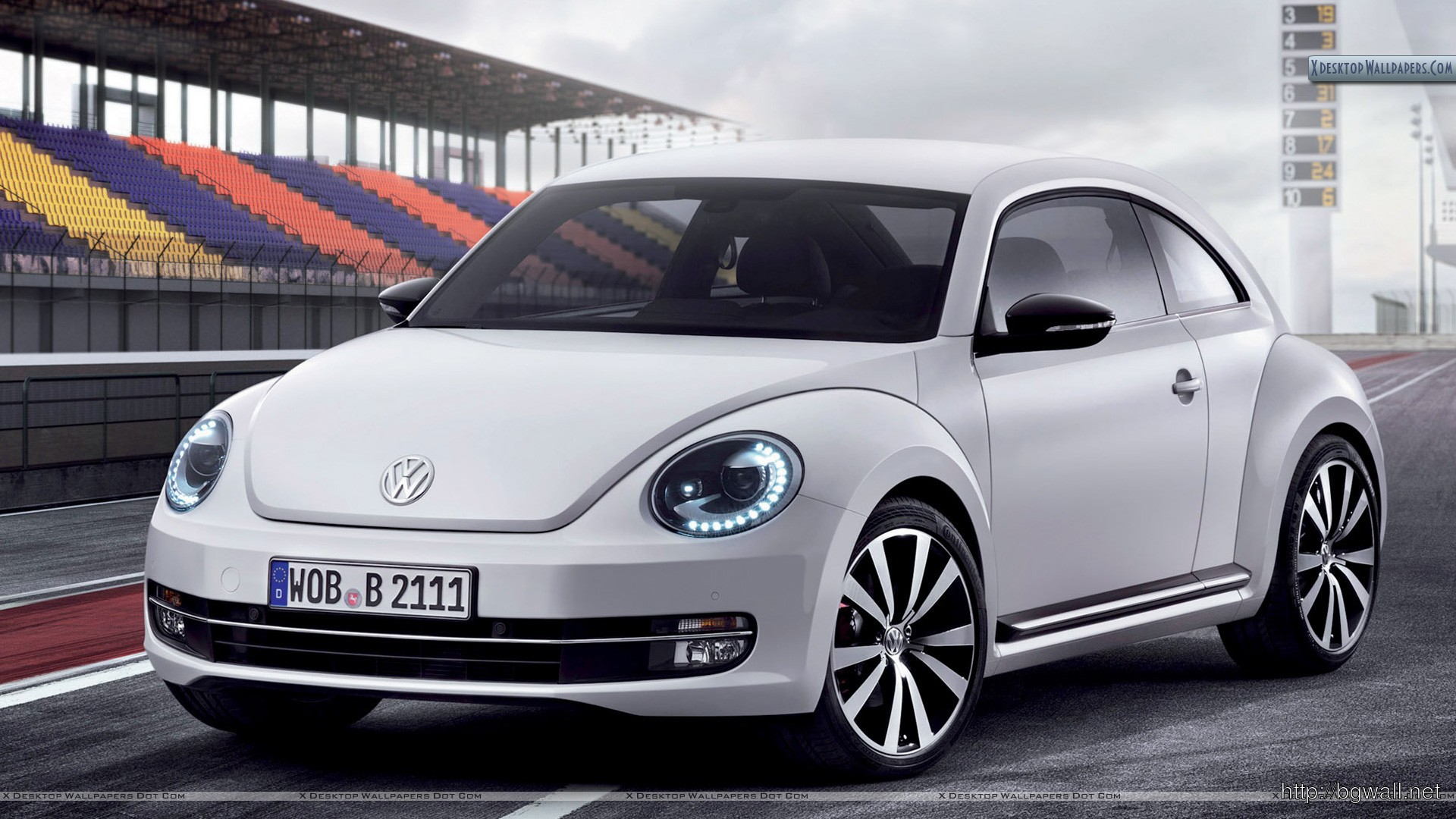 2012 Volkswagen Beetle On Race Course Wallpaper Full Size