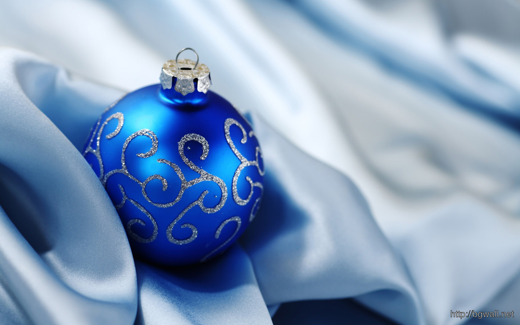 Download Christmas Ball On Silk Wallpaper Background