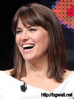 Lucy Lawless Laughing out Loud Wallpaper