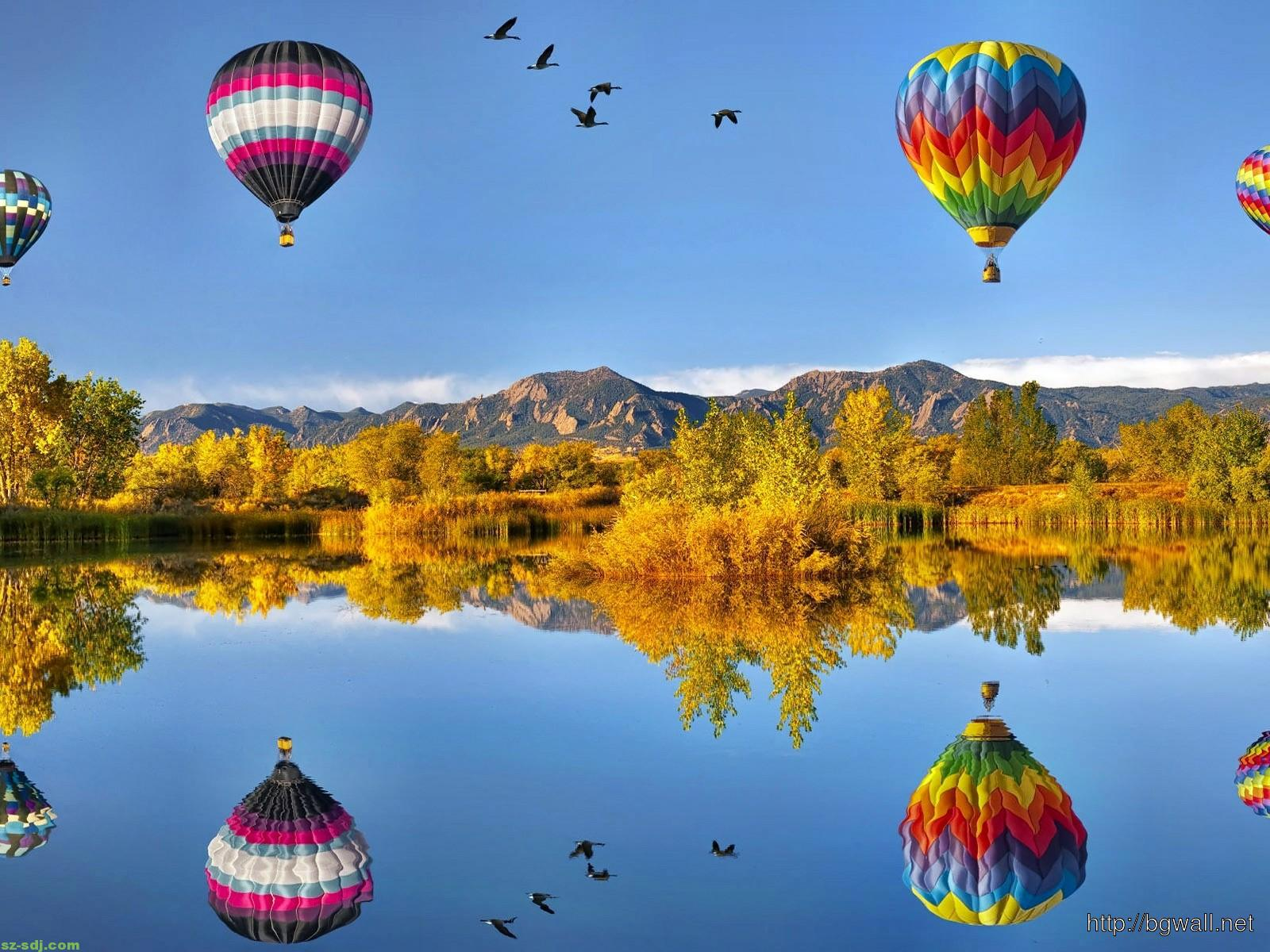 hot air balloons flying over the lake wallpaper image