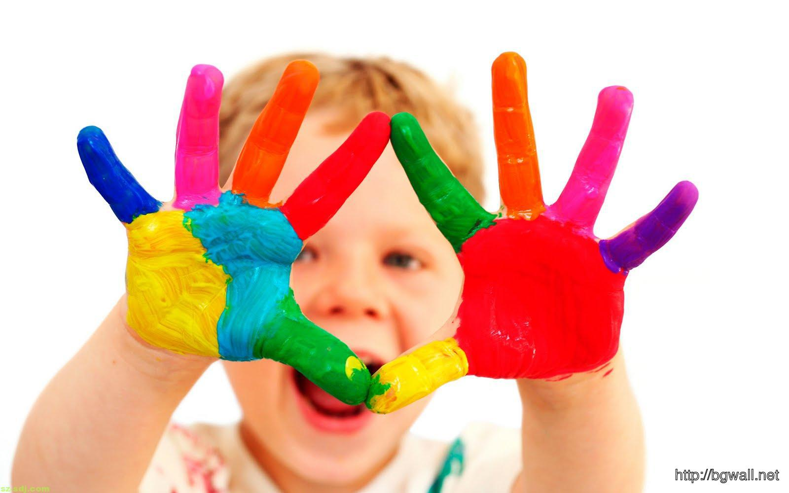 A Child With Colorfull Hand Wallpaper Background
